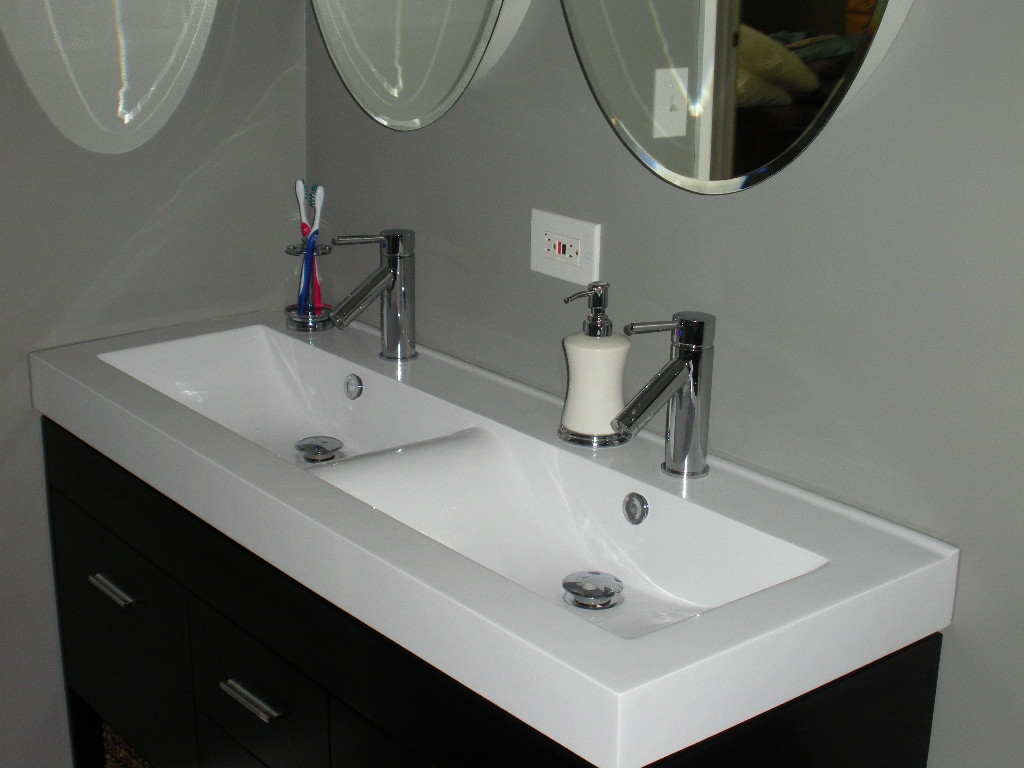 One Large Bathroom Sink With 2 Faucets